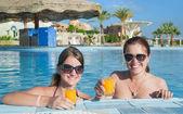 Girls with orange juice — Stock Photo