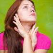 Girl in pink over green — Stock Photo