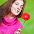 Stock Photo: Girl in pink with red flower