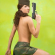 Girl in garrison cap with gun — Stock Photo