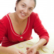 Stockfoto: Woman making meat dumplings