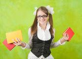 Schoolgirl with books — Stock Photo