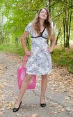 Girl with pink handbag — Stock Photo