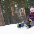 Child sliding in snow — Stock fotografie #2730054