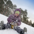 Child sliding in the snow — Stock fotografie