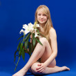 Sitting nude girl with lily — Stock Photo