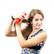 Girl spraying hair over white — Stock Photo