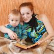 Mother with sonreading book — Stock Photo #3107195