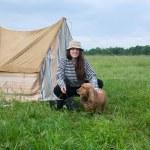 Girl with dog at camping — Stock Photo #3107528