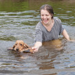 Girl and dog plays — Stock Photo #3107547