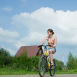 Stock Photo: Girl goes on bicycle