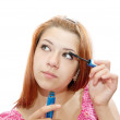 Stock Photo: Girl puts mascara on