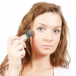 Woman putting make up on her face - Foto Stock