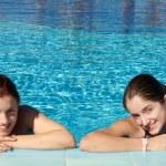 Girls against resort background — Stock Photo #3108876