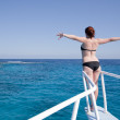 Woman sunbathing on the ship — Stock Photo