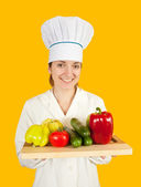Female cook with vegetables — Stock Photo