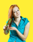 Girl combing her red hair — Stock Photo