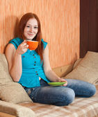 Girl with cup of tea — Stock Photo