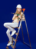 Topless girl on scaling-ladder — Stock Photo