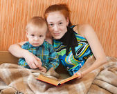 Mother with sonreading book — Stock Photo