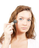 Woman putting make up on her face — Stock Photo