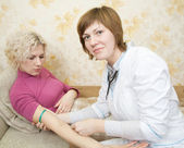 Doctor or nurse and a patient — Stock Photo