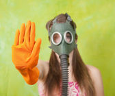 Girl in gas mask pointing STOP — Stock Photo