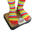 Feet placed on scales — Stock Photo