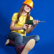 Stock Photo: Girl with drill