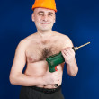 Man in  hard hat with drill — Stock Photo