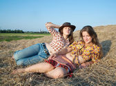 Girls laying in hay — Stock Photo
