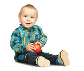 Boy in chequered shirt with apple — Stock Photo