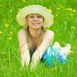 Girl in hat relaxing in grass — Stock Photo