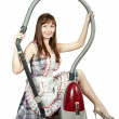 图库照片: Girl in with vacuum cleaner