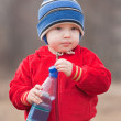 Little boy drinking water — Stock Photo