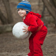 Little boy plays with ball — Stock Photo