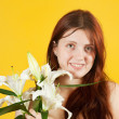 Girl with white lily — Stock Photo #3406328