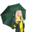 Blonde girl  in green coat  with umbrella - Stockfoto