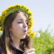 Girl blowing a dandelion — Stock Photo
