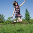 Jumping  teen girl - Stockfoto