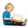 Two-year boy  with book — Stockfoto