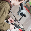 Stock Photo: Jeweller working with microscope