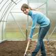 Woman working with shovel — Stock Photo