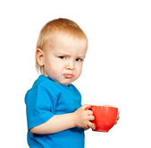 Boy in blue shirt with cup — Stock Photo