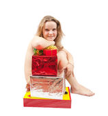 Girl sitting nudity with gifts — ストック写真