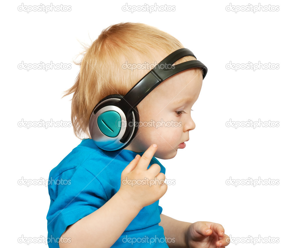 Little nice boy listening to music, isolated on white  — Stock Photo #3407671