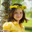Girl in  dandelion wreath — Stock Photo