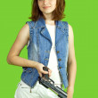 Girl in white with gun — Stock Photo