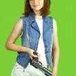 Girl in white with gun — Stock Photo #3412953