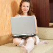 Royalty-Free Stock Photo: Girl  with laptop on sofa